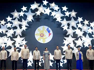 President Donald Trump and Philippines president Rodrigo Duterte join other leaders for a photo at an ASEAN Summit dinner. AP