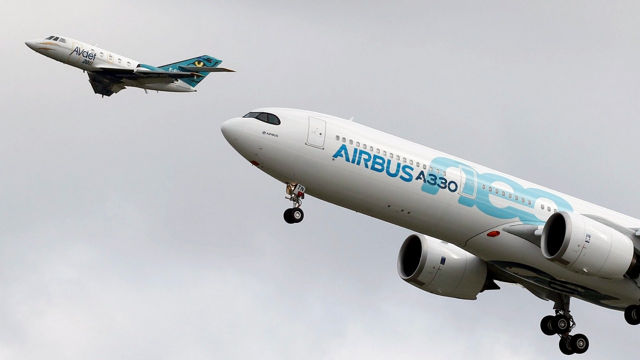 An Airbus A330neo aircraft lands as a Dassault Aviation Falcon jet of AVdef (Aviation Defense Service) flies nearby during its maiden flight event in Colomiers near Toulouse. Reuters.