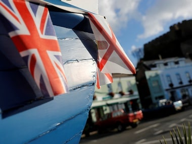 Union and Jersey flags hang from an old fishing boat in Gorey, Jersey, Britain. Reuters.