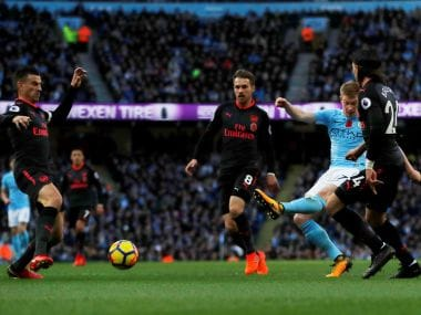 Manchester City's Kevin De Bruyne scores their first goal against Arsenal. Reuters