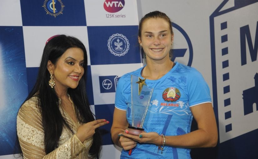 Aryna Sabalenka (right) poses with the trophy after winning the final of the L&T Mumbai Open WTA ​1​25K Series​. Firstpost