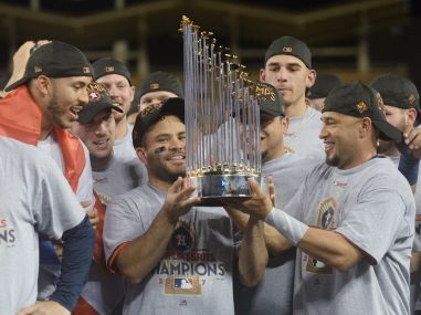 Houston Astros' Jose Altuve is presented the Commissioner's Trophy after defeating the Los Angeles Dodgers. Reuters