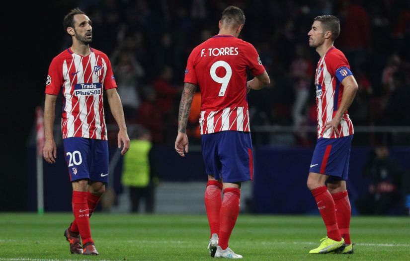 Soccer Football - Champions League - Atletico Madrid vs Qarabag FK - Wanda Metropolitano, Madrid, Spain - October 31, 2017 Atletico Madrid's Fernando Torres, Juanfran and Gabi look dejected after the match REUTERS/Sergio Perez - RC1A12F71450