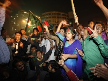 In this file image, Bangladeshis celebrate after hearing the news of the execution of those convicted for crimes in the 1971 war. Reuters