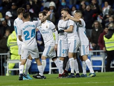 Real Madrid's Borja Mayoral, second right, is congratulated by teammates after scoring his side's first goal against Fuenlabrada. AP