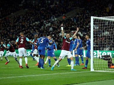 West Ham United's Cheikhou Kouyate, left, celebrates scoring his side's first goal of the game during the English Premier League soccer match between West Ham United and Leicester City, at the London Stadium, in London, Friday Nov. 24, 2017. (Adam Davy/PA via AP)
