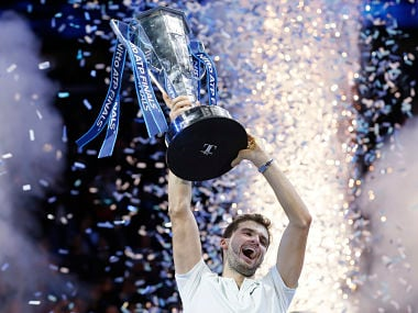 Grigor Dimitrov of Bulgaria lifts the trophy after beating David Goffin of Belgium in their ATP World Tour Finals singles final tennis match at the O2 Arena in London, Sunday Nov. 19, 2017. (AP Photo/Tim Ireland)