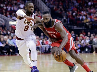 Houston Rockets guard James Harden (13) drives past Cleveland Cavaliers guard Dwyane Wade (9) during the second half of an NBA basketball game Thursday, Nov. 9, 2017, in Houston. (AP Photo/Michael Wyke)