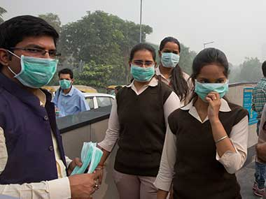 Volunteers distribute face masks in New Delhi. AP