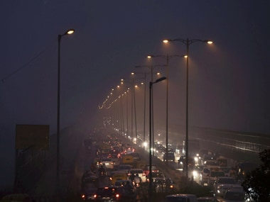 People commute through smog in New Delhi on Tuesday. PTI