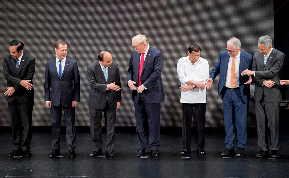 US president Donald Trump messed up a carefully choreographed handshake routine at the ASEAN summit in Manila. AFP