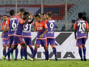 FC Pune City players form a huddle after scoring their fourth goal against ATK. ISL
