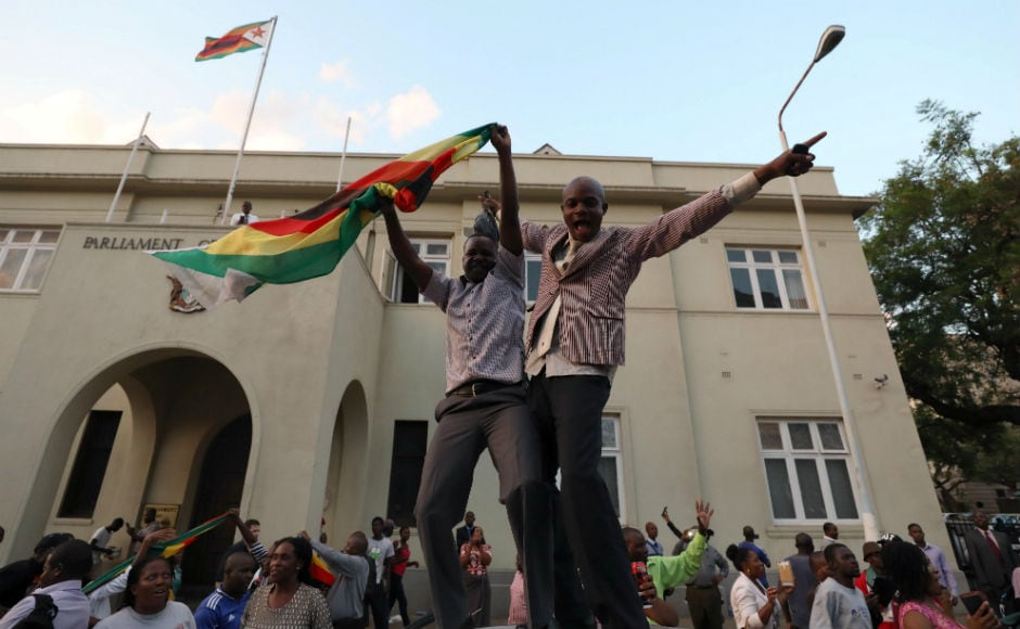 The streets of Zimbabwe's capital, Harare, erupted in celebration on Tuesday after President Robert Mugabe resigned, ending 37 years in power. Reuters