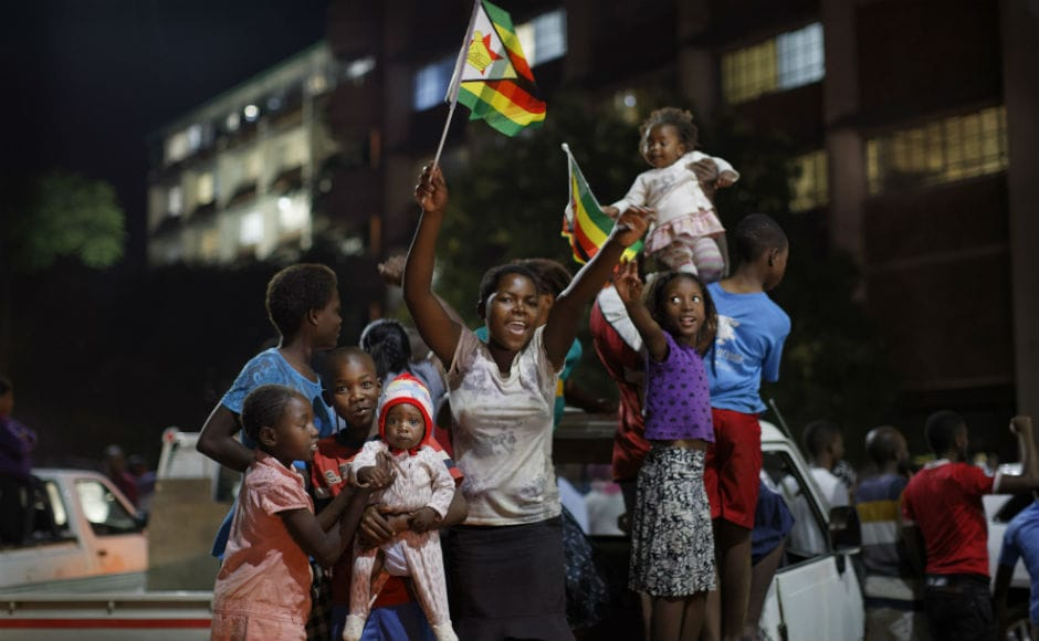 The crowds gathered brandishing national flags and often praising army chief General Constantino Chiwenga who led the military's power-grab. Some people were holding posters of Zimbabwean army chief Constantino Chiwenga and Mnangagwa, whose sacking this month triggered the military takeover.