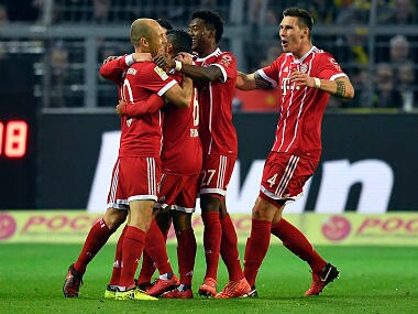 Bayern's scorer Arjen Robben, front left, and his teammates celebrate the opening goal during the German Bundesliga soccer match between Borussia Dortmund and FC Bayern Munich in Dortmund, Germany, Saturday, Nov. 4, 2017. (AP Photo/Martin Meissner)