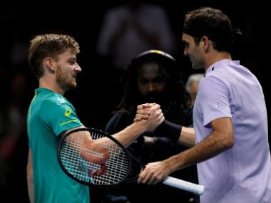 Belgium's David Goffin shakes hands with Switzerland's Roger Federer after winning their semi final match. Reuters
