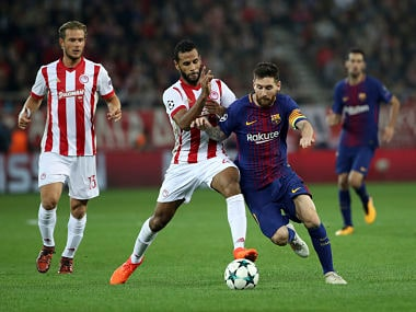 Barcelona's Lionel Messi, right, challenges Olympiacos' Alaixys Romao during the Champions League group D soccer match between Olympiakos and Barcelona at Georgios Karaiskakis stadium at Piraeus port, near Athens, Tuesday, Oct. 31, 2017. (AP Photo/Petros Giannakouris)