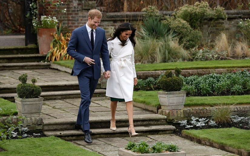 Britain's Prince Harry and his fiancee Meghan Markle arrives for a photocall in the grounds of Kensington Palace in London, Monday Nov. 27, 2017. Britain's royal palace says Prince Harry and actress Meghan Markle are engaged and will marry in the spring of 2018. (AP Photo/Matt Dunham)