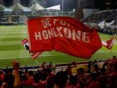Hong Kong fans wave banners during a friendly match. Reuters