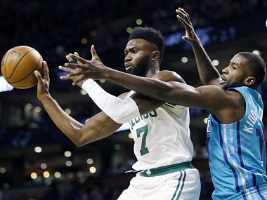Boston Celtics' Jaylen Brown (7) passes under pressure from Charlotte Hornets' Michael Kidd-Gilchrist during the first quarter of an NBA basketball game in Boston, Friday, Nov. 10, 2017. (AP Photo/Michael Dwyer)