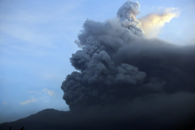 A view of the Mount Agung volcano erupting at sunrise in Karangasem on Sunday. AP