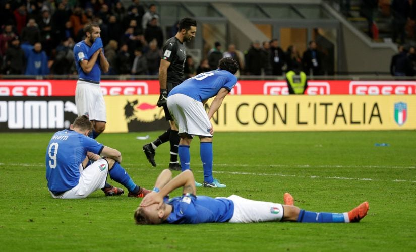 Italy players look dejected after the match against Sweden. Reuters