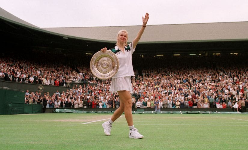 File photo of Jana Novotna with the winner's trophy after victory over Nathalie Tauziat in the women's singles final at Wimbledon in 1998. Novotna won the match 6-4, 7-6. Reuters