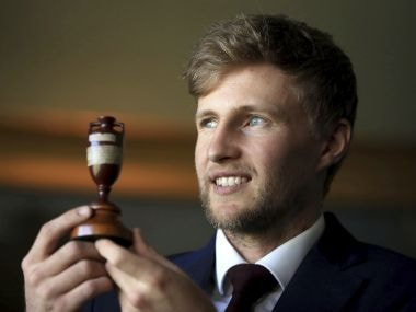 England's team captain Joe Root holds the Ashes trophy as he faces the media at Lord's in London, Friday Oct. 27, 2017.  Current holders of the Ashes England cricket team depart for Australia on Saturday in preparation for the start of the upcoming Ashes Series. (Adam Davy/PA via AP)