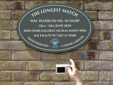 A spectator photographs a plaque of the match in 2010 that lasted more than 11 hours. Reuters