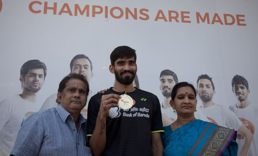 India's Kidambi Srikanth and his parents pose with his medal before a press conference at the Pullela Gopichand Academy in Hyderabad on Tuesday. AP