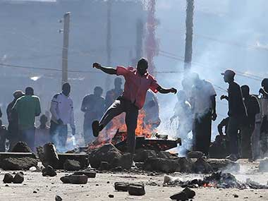 Opposition supporters block a road and burn tyres during clashes with riot police in Mathare slums in Nairobi, Kenya. AP