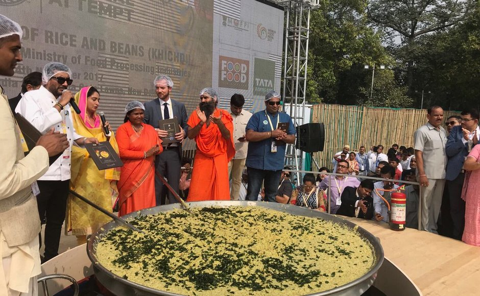 India set a new GuinnessWorld Record on Saturday by cooking 918 kilograms of 'Khichdi', a traditional multi-grain dish at the World Food India event in Delhi. Harsimrat Kaur Badal, Baba Ramdev and chef Ranveer Brar cooking Khichdi during the event. Twitter@HarsimratBadal_