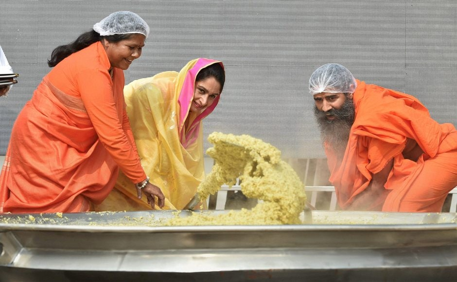 The minimum requirement to set the record was 500 kilograms, however, with the help of over 50 chefs, India managed to cook over 900 kilograms of Khichdi. Badal along with Sadhvi Niranjan Jyoti and Swami Ramdev cooking Khichdi. PTI