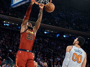 Cleveland Cavaliers' LeBron James, left, dunks over New York Knicks' Enes Kanter (00) during the first half of a NBA basketball game at Madison Square Garden in New York, Monday, Nov. 13, 2017. (AP Photo/Andres Kudacki)