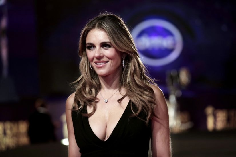 Elizabeth Hurley smiles on the red carpet during the opening of the 39th Cairo International Film Festival in Egypt, Tuesday, Nov. 21, 2017. (AP Photo/Nariman El-Mofty)