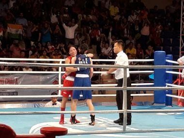 India's Mary Kom (in red) celebrates after winning the gold medal at the Asian Boxing Championships