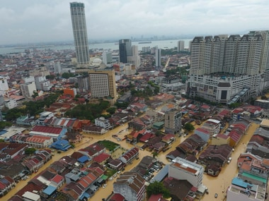 An aerial view shows a flooded George Town city in Penang, Malaysia on Sunday. AP