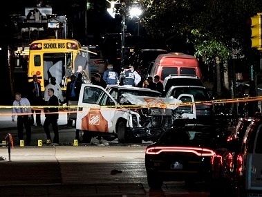 Authorities near a damaged Home Depot truck after a motorist drove onto a bike path near the World Trade Center memorial, striking and killing 8 people. AP