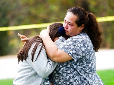 Students being consoled after the hostage situation at a Los Angeles school was brought under control. AP