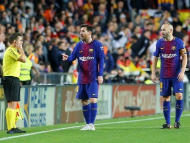 Barcelona's Lionel Messi remonstrates with the assistant referee after he was denied a goal. Reuters