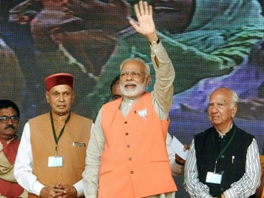 Prime Minister Narendra Modi, with chief ministerial candidate PK Dhumal and senior leader Shanta Kumar, waves at the crowd at an election campaign rally in Kangra district on Thursday. PTI