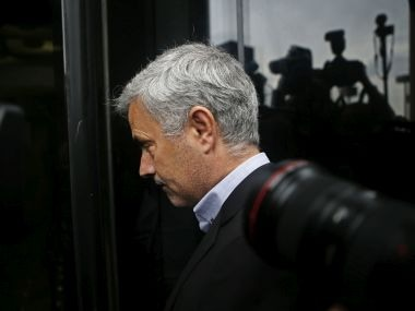 Manchester United manager Jose Mourinho enters a courthouse in Madrid, Spain, Friday, Nov. 3, 2017. Mourinho was summoned by a Madrid court over tax fraud accusations. (AP Photo/Paul White)