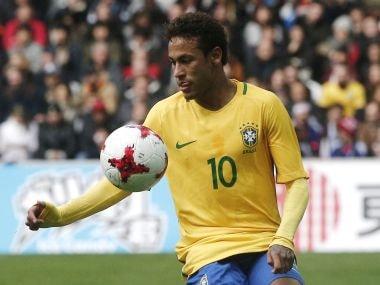 Brazil's Neymar controls the ball during their international friendly against Japan. AP