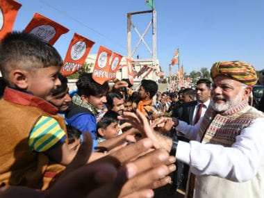 Prime Minister Narendra Modi meeting locals before the Bhuj rally on Sunday. Twitter @narendramodi