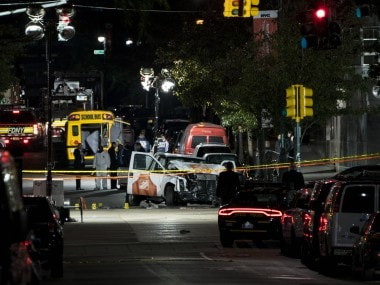 New York Police Department at the scene of the attack on Tuesday night. AP
