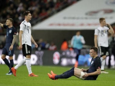 England's Phil Jones sits on the ground injured just before he is replaced during an international friendly. AP