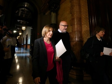Carme Forcadell, speaker of the Catalan regional Parliament, leave a Parliament board meeting with deputies Lluis Corominas and Anna Simo in Barcelona. Reuters