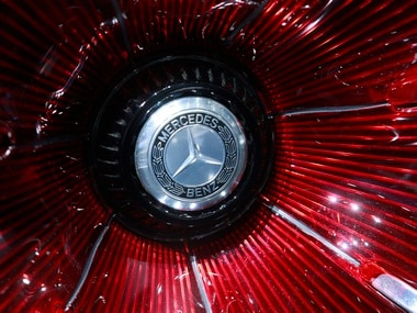 A Mercedes sign is seen on the car before the Daimler annual shareholder meeting in Berlin, Germany. Reuters