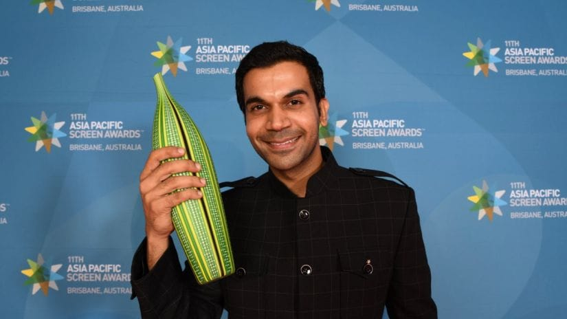 Rajkumar Rao poses with the Best Actor trophy at Asia Pacific Screen Awards. Twitter/@APScreenAwards