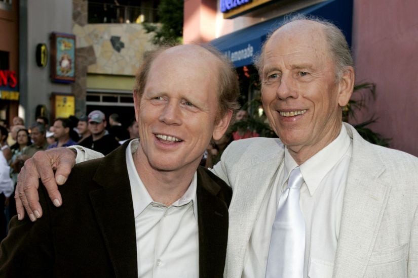 "Director Ron Howard and father Rance Howard (R) arrive for the premiere of his new film ""Cinderella Man"" at Universal CityWalk in Los Angeles May 23, 2005. The film set in the 1930's in the United States tells the true story of boxer Jim Braddock and stars Australian actor Russell Crowe and actress Renee Zellweger and also features Rance Howard. The film opens in the United States June 3. REUTERS/Fred Prouser FSP - RP6DRMRSRPAC"